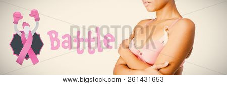 Battle text with female likeness and breast cancer awareness ribbon against woman for breast cancer awareness with ribbon