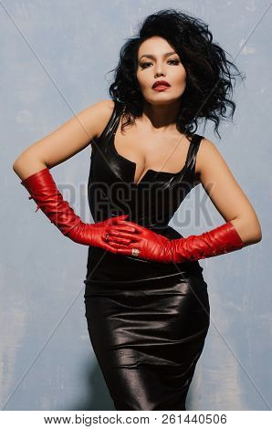Beautiful Adult Woman Wearing Black Spandex Dress And Long Red Leather Gloves.