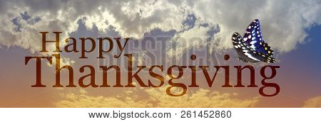Happy Thanksgiving Butterfly Clouds Banner - A Moody Warm Coloured November Evening Sky With The Wor