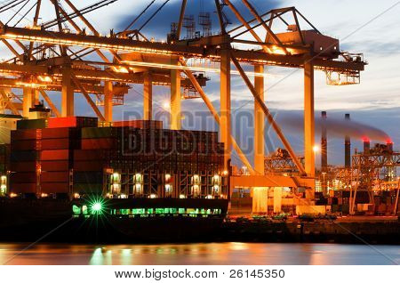 The motion and activity of a container terminal at dusk, with all facets of the harbor: the ships, the containers, the cranes, the carriers, the processing industry.