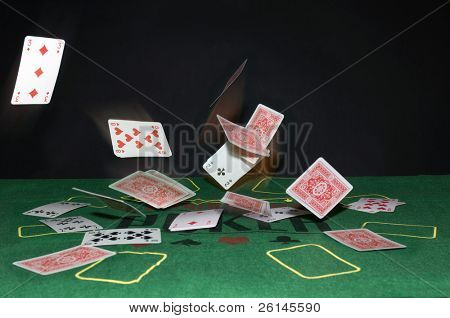 A Texas Hold 'm Poker theme with playing cards bouncing off the table in all directions.