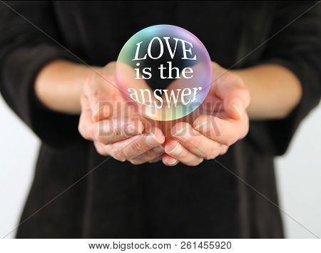 Love Is Always The Answer - Large Transparent Ball Floating Above Female Cupped Hands Containing The