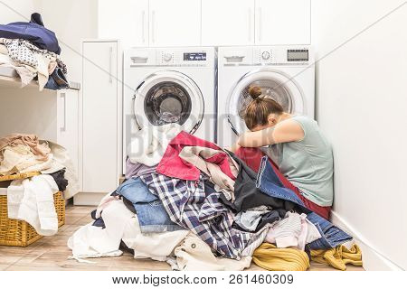 Sad Woman Sitting In A Laundry Room
