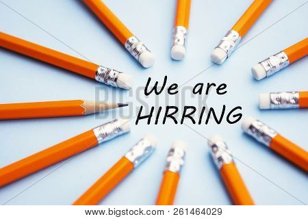 We Are Hiring Yellow Pencils Over Blue Background With The Inscription We Are Hiring.