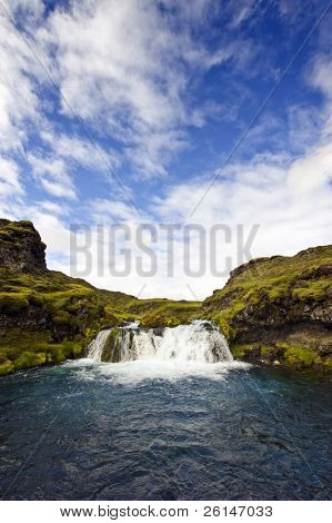 A small, hidden and obscured waterfall in the Icelandic National Park Landmannalaugar