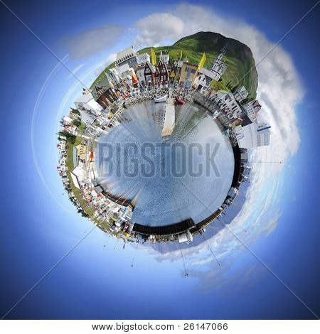 Living in your own world makes life simple and pleasant. A spherical manipulation of a panoramic stitch from 34 images of the arctic fishing village of Husavik, Iceland poster