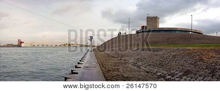Panoramic image of the civil engineering marvel of the Caland barrage in the Europoort, the Netherlands just before sunset