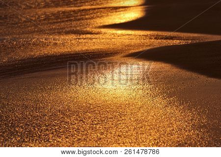 Sand Beach And Sea Wave In Sunset Light, Tranquil Summer Background.orange Sunset. Sea Sunset In Vie