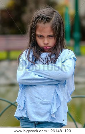 Angry Little Girl Showing Frustration And Disagreement