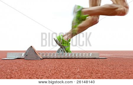 Action packed image of an athlete leaving the starting blocks for a sprint run on a track poster