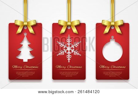 Christmas Tags On White Background With Golden Ribbon. New Year Holidays Hang Tag Labels. Cut Out Pa
