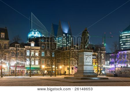 The nightlife district of The Hague, the Netherlands, with its monumental old buildings, and a brand new, modern skyline in the background