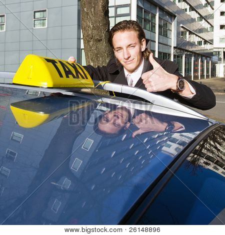 A smiling taxi driver giving a thumbs up while placing his taxi sign on the roof of his car poster