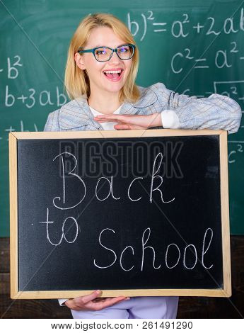 Top Ways To Welcome Students Back To School. Teacher Woman Hold Blackboard Inscription Back To Schoo