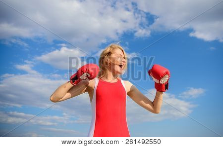 Woman Strong Boxing Gloves Raise Hands Blue Sky Background. Girl Boxing Gloves Symbol Struggle For F