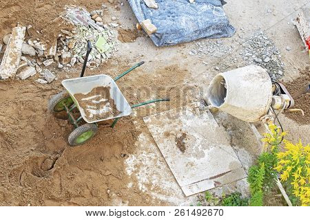 Construction Site. View From Top. Wheelbarrow And Concrete Mixer