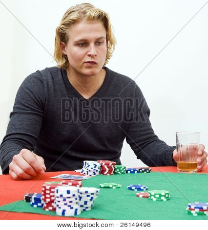 A poker player in deep thought to decide the strategy of his game