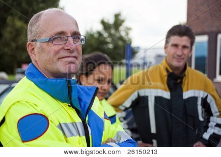Senior paramedic, wearing a uniform looking into the camera with a confident look in his eyes
