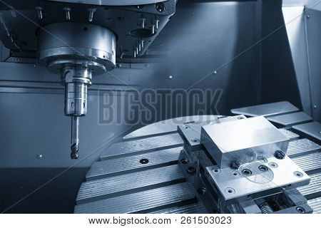 The 5-axis Cnc Milling Machine With The Solid Radius End-mill Tool And The Raw Blank Material On The