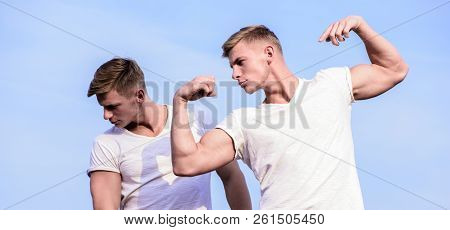 Attractive Twins. Sport Lifestyle And Healthy Body. Men Twins Brothers Muscular Guys Sky Background.