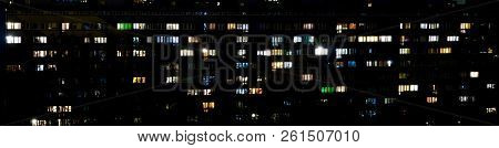Windows Of Apartment Buildings At Night, The Light From The Windows Of Houses, The Evening Landscape