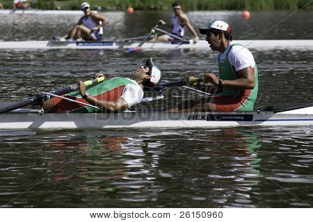 AMSTERDAM-JULY 22:  Cabrera and Cuevas (Mexico Men's Pair) are exhausted after the finish of the world championships rowing under 23. On July 22, 2011 in Bosbaan, Amsterdam, The Netherlands
