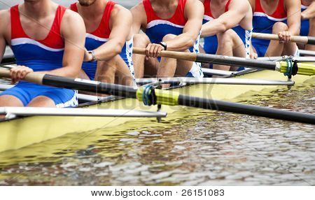 Mens Eight rowing team at the start of a regatta poster