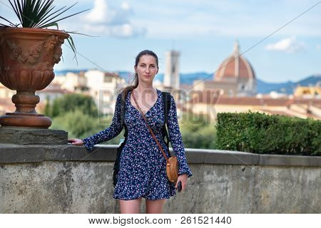 Romantic young beautiful girl in ancient city center, Florence, Tuscany, Italy. Outdoor female portrait in Boboli Gardens, Florentine amazing landscape.