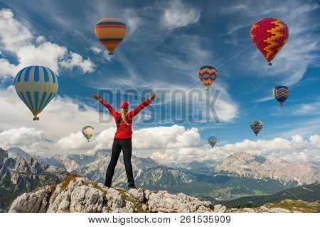 Sporty Girl And A Lot Of Hot Air Balloons. The Feeling Of Complete Freedom, Achievement, Achievement