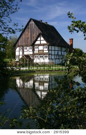 Old half timbered house at a village pond poster