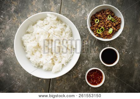Korean Soy Beef Bowl - Dish With Rice, Soy Meat And Chili Sauce