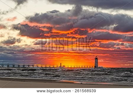 Sunset Lighting Up The Sky Giving It The Look Of Fire Over Lake Michigan