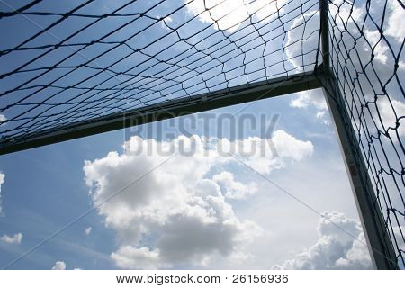 Corner of the soccer goal with vibrant clouds