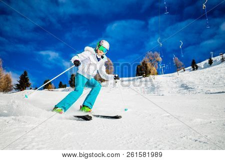 Girl on skiing on snow on a sunny day in the mountains. Ski in winter seasonon, the tops of snowy mountains in sunny day.