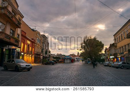 Uzhgorod, Ukraine - Sep 28, 2008: Petefi Square On A Cloudy Autumn Sunrise. Old Town Awaiting For To