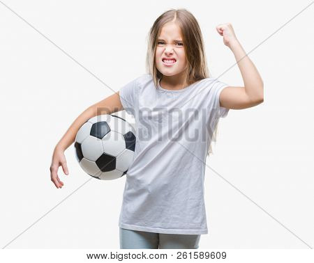Young beautiful girl holding soccer football ball over isolated background annoyed and frustrated shouting with anger, crazy and yelling with raised hand, anger concept