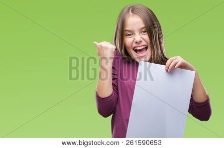 Young beautiful girl holding blank sheet paper over isolated background screaming proud and celebrating victory and success very excited, cheering emotion