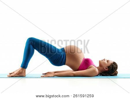Pregnant Woman Does Yoga Exercise On Last Months Of Pregnancy Isolated On White Background. Concept