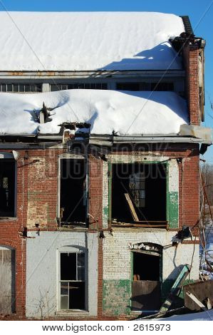 Damaged Home In Winter