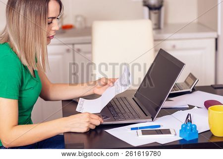 Budget Planning - Young Woman At Home Planning Family Budget And Finances.