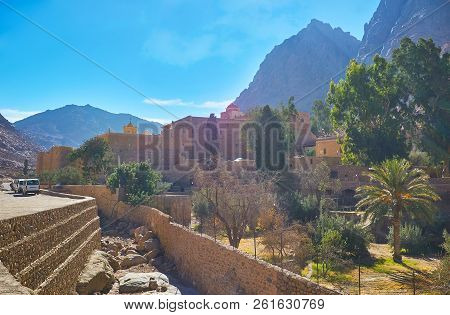 The garden and massive rampart of the Sacred Monastery of the God-Trodden Mount Sinai (St Catherine Monastery), one of the oldest working Christian monasteries in world, Egypt. poster
