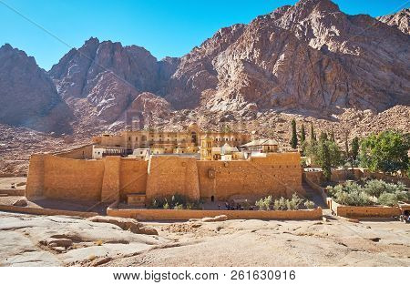 The Sacred Monastery Of God-trodden Mount Sinai (st Catherine Monastery) Is Surrounded By Red Rocks