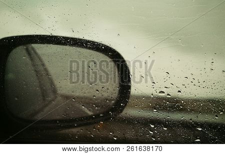 Dramatic Imagine Of Rear View. Image Of The View Through The Rear-view Mirror. What We Left Behind.