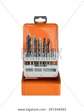 Collection Of Different Drills In A Orange Metal Box, Isolated On White
