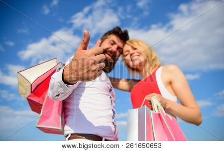 Happy Couple Satisfied Purchases. Shopping Brings Positive Emotions. Couple With Shopping Bags Hugs