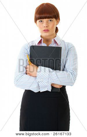 young redhead female holds yellow pencil and black notepad, isolated on white