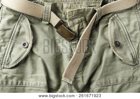 pants khaki belt. well visible fabric texture. the belt is unbuttoned poster