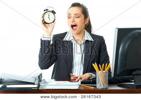 young female tired sleepy office worker holds clock in her hand, isolated on white