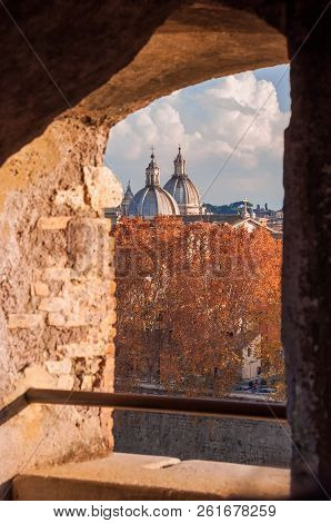 Autumnal view of Rome historic center from Castel Sant'Angelo old embrasure