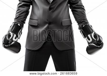 Business career and professional competition success concept - businessman boxer in black suit wearing sport boxing gloves white isolated